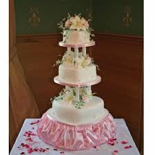 sam love heart shaped wedding cake tiers with hand made flowers