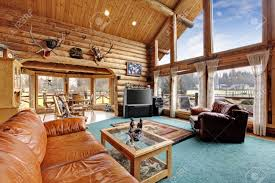 living room large living room with diining area in log cabin