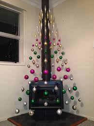 avant garde tree using existing fireplace as the prop