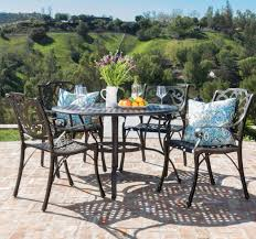 48 Inch Round Table by Calandra Cast Aluminum 5 Piece Outdoor Dining Set With 48