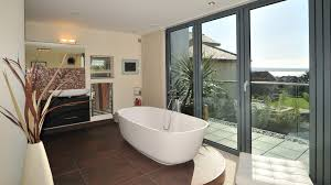 modern seaside architecture in poole western design architects open plan en suite and bedroom design aura poole