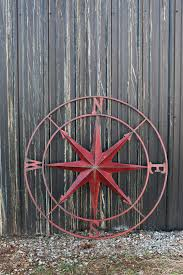 very large round metal compass rose 41