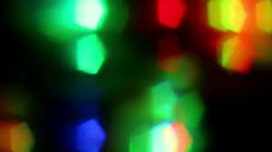 bright multicolored disco lights in nightclub soft focus stock