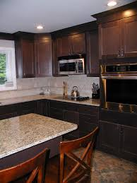 kitchen counters and backsplash dce wall oven microwave over stove granite countertops tile