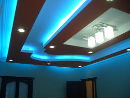 modern living room pop ceiling design with blue led lights and 3