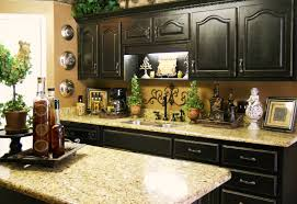 classic oak wall cabinets and small island near marble kitchen