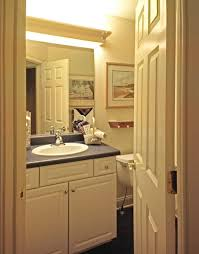 bathroom black countertop and contemporary bathroom lighting