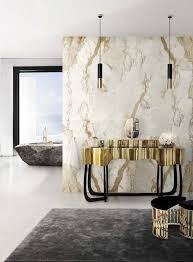 sleek tubular pendant lamps with white marble wall design with