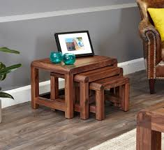 sophisticated walnut nested coffee tables set of three