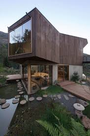 Haus In Haus Biofilter Teich Und Naturnahe Materialien Ein Haus In Chile