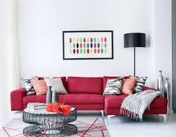 contemporary family room with a red sectional sofa and mounted tv