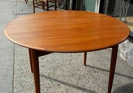 Teak Round Dining Table - Scandinavian teak dining room furniture