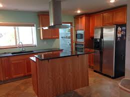 full kitchen with island and range hood