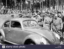 first volkswagen beetle 1938 ferdinand porsche with adolf at a volkswagen 1938 stock