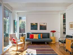 comfortable apartment sized furniture living room with colourful