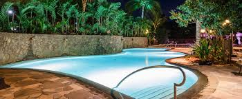 photos videos aulani hawaii resort spa a pool with a high curving rock wall with shell like water spouts and