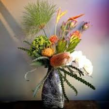 flower delivery rochester ny pomegranate centerpiece by k floral let s party winter