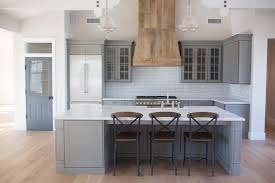 Grey farmhouse kitchen open concept custom barnwood hood