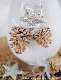 Decorating Pine Cones With Glitter Diy Bleached And Glittered Pine Cone Ornaments Town U0026 Country Living