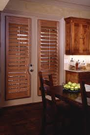 Wooden Patio Door Blinds by Norman Wood Door Shutter With Cutout Shutters Are An Unobtrusive