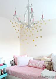 little girls bedroom with pink bliss benjamin moore gold vinyl little girls bedroom with pink bliss benjamin moore gold vinyl raindrop decals on the wall with chandelier and decor cute for a nursery colour palette as