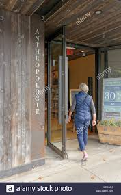 anthropologie stock photos anthropologie stock images alamy woman entering anthropologie women s clothing and accessories and home decor store on south granville street