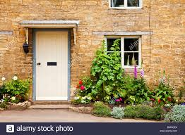 White Front Door White Front Door Of A Typical Cotswold Stone Village House With A
