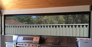 Outdoor Patio Roll Up Shades by Roller Blind Covering An Outdoor Bbq Patio Area Outdoor Blinds