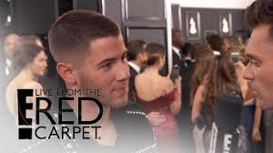 E Red Carpet Grammys Nick Jonas Sports Stunning Balmain Jacket At 2017 Grammys E