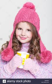 happy child in winter clothes and chocolate cute baby