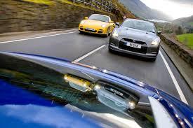 nissan gtr vs porsche 911 porsche 911 turbo v nissan gt r v audi r8 v10 evo