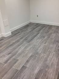 i a grey wood tile floor flipping houses