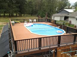 pool rails in ground pool steps patio umbrellas wooden fence pool
