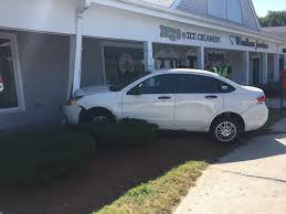 car crashes into shopping plaza new hampshire eagletribune com