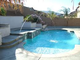 Custom Pools By Design by Pool Design Simple Custom Pool Design Featuring Raised Jacuzzi