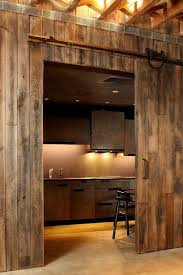 Salvaged Barn Doors by 25 Trendy Kitchens That Unleash The Allure Of Sliding Barn Doors