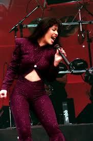 selena quintanilla purple jumpsuit growing up xicana looking back on la reina selena 21 years after