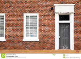 red brick wall with door and windows stock photo image 54216115