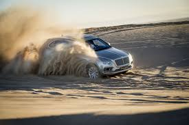bentley suv offroading in the bentley suv that costs 12 hondas the verge