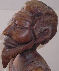 haitian carved wood sculpture of a i a and