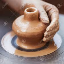 potter hands making in clay on pottery wheel potter makes on