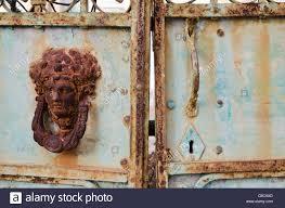decorative door knockers rusty old decorative door knocker on a weathered gates in patmos