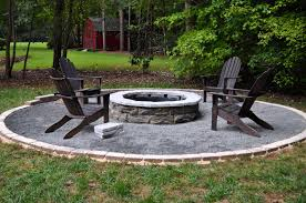 exterior rounded fire pit which combined with larger stone