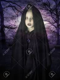 ghost of a child appearing in the haunted forest stock photo