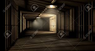 corridor lighting a corridor in a prison at night showing jail cells illuminted