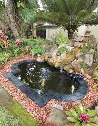 backyard with small koi pond and using river rocks maintenance