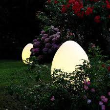 backyard lamp post green grass patio slab post light river stone