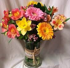 Gerbera Daisies Touch Of Spring Cute Raffia Ribbon Detail On Vase With Lillies
