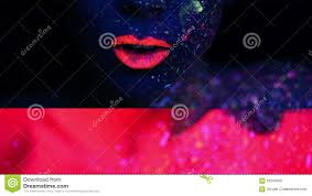woman face with fluorescent make up stock video video 62333209