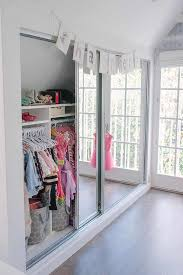 Mirrored Sliding Doors Closet Well Organized Kid Closet With Mirrored Doors Transitional
